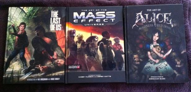 Here are my artbooks, I'm trying to collect more from my favorite games.