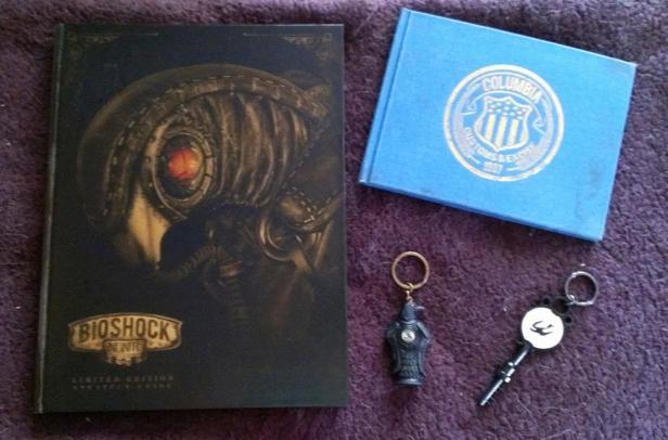 On the left is my Bioshock Infinite LE strategy guide, the key on the bottom right came with it. Top right is the small Infinite artbook that came with the game's CE along with the Murder of Crows keychain.