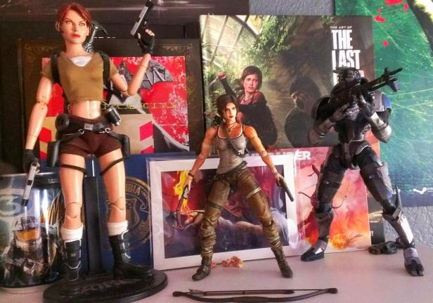 My two Lara Croft action figures and my Garrus figure.