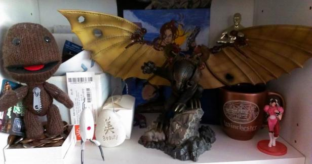There is mostly random stuffo n this shelf including my Songbird statue, a Sackboy plushie and a Portal turret that lights up and talks.