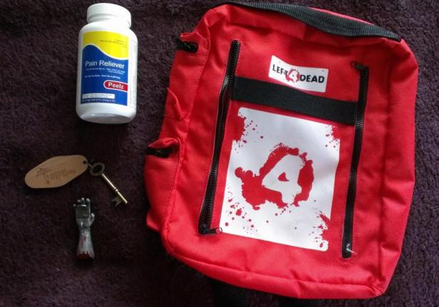 """This is a Left 4 Dead Med-Kit backpack with """"Peelz"""". The keychain and bottle opener are from Dead Island Riptide."""